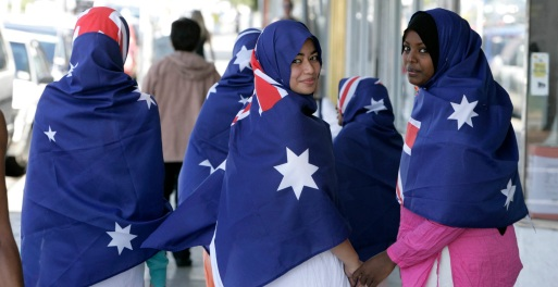 **FILE** A March 21, 2006 file photo of young muslim women modelling Australian flag hijabs as part of national Harmony Day, coinciding with the United Nations Interntional Day for Elimination of Racial Discrimination, in Melbourne. Brisbane radio presenter Michael Smith Thursday, Jan. 15, 2009, called for a ban on Islamic hijabs, saying that they posed a security risk because it obscured the face, making it difficult to identify the wearer in the instance of a crime. (AAP Image/Glenn Hunt, File) NO ARCHIVING